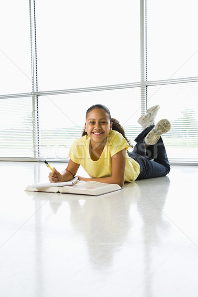 Girl doing schoolwork. Stock photo © iofoto