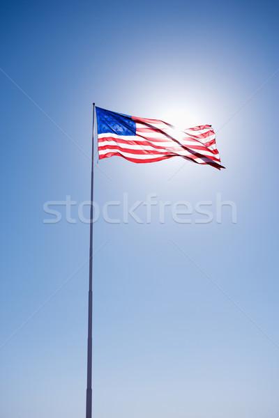 Bandeira americana céu blue sky fundo bandeira Foto stock © iofoto
