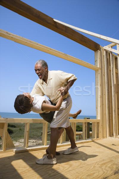 Happy couple at new home site. Stock photo © iofoto