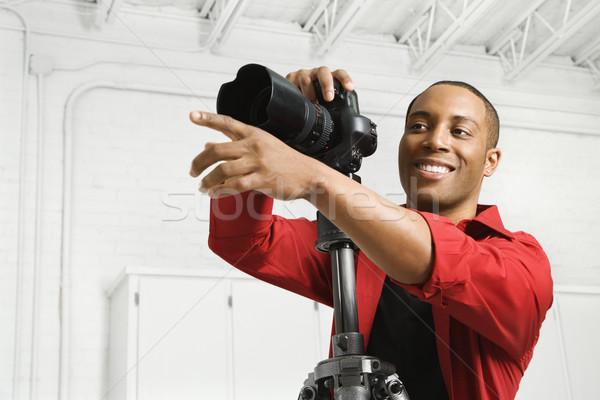 Człowiek kamery młodych mężczyzna dorosły Zdjęcia stock © iofoto