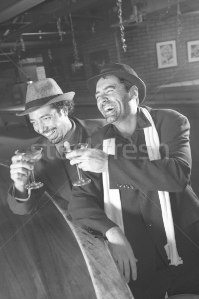 Men laughing and drinking. Stock photo © iofoto