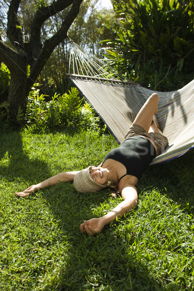 Woman lounging on hammock. Stock photo © iofoto