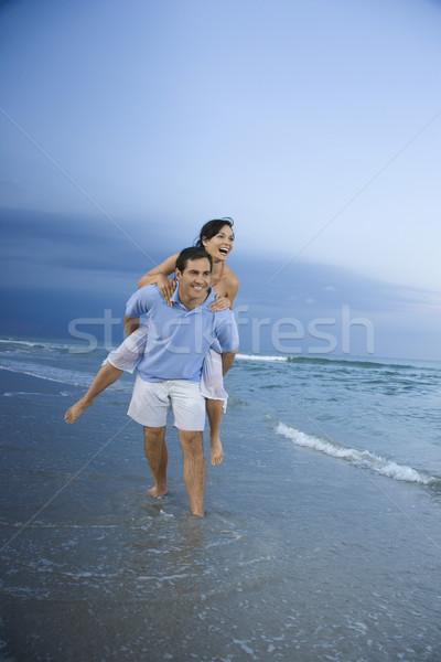 Man carrying woman. Stock photo © iofoto