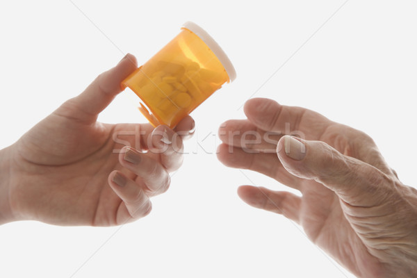 Hands with pill bottle. Stock photo © iofoto