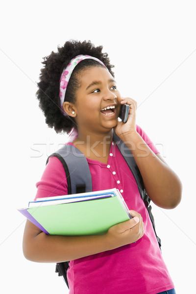 Schoolgirl with phone. Stock photo © iofoto