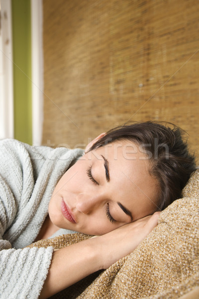 Woman in robe sleeping. Stock photo © iofoto