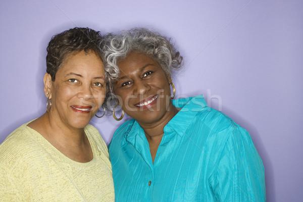 Two women smiling. Stock photo © iofoto