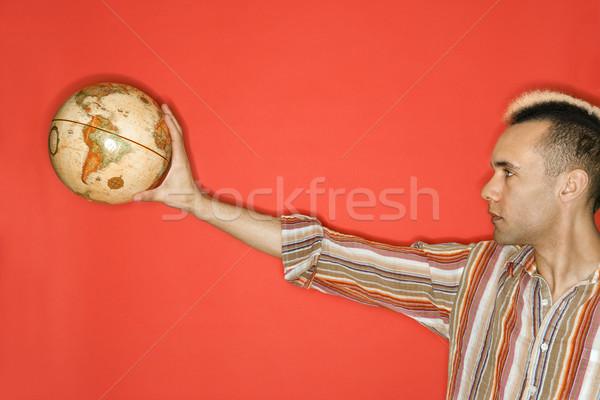 Man holding world globe. Stock photo © iofoto