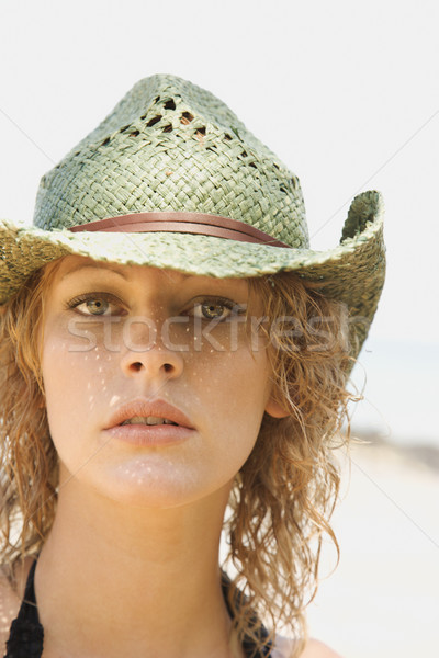 Young woman wearing cowboy hat. Stock photo © iofoto