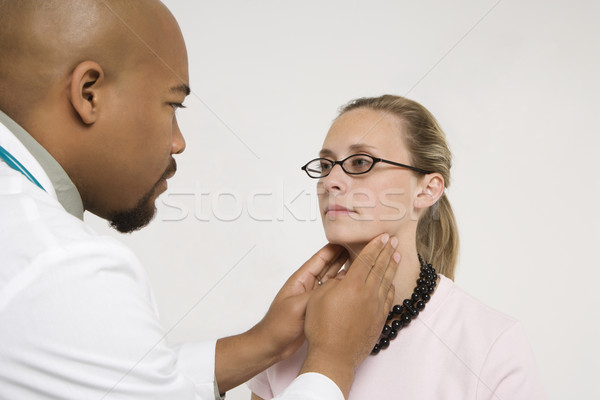 Doctor examining patient. Stock photo © iofoto