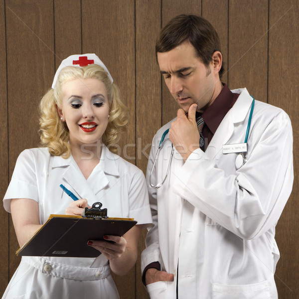 Retro enfermeira médico caucasiano feminino médico do sexo masculino Foto stock © iofoto