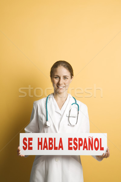 Stock photo: Doctor and Spanish sign.