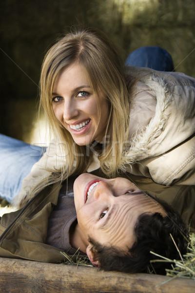 Couple cuddling in hay. Stock photo © iofoto
