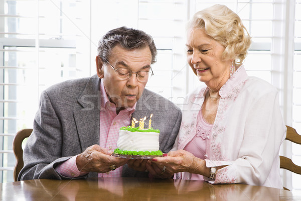 Mature couple with cake. Stock photo © iofoto