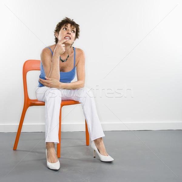 Pondering woman portrait. Stock photo © iofoto