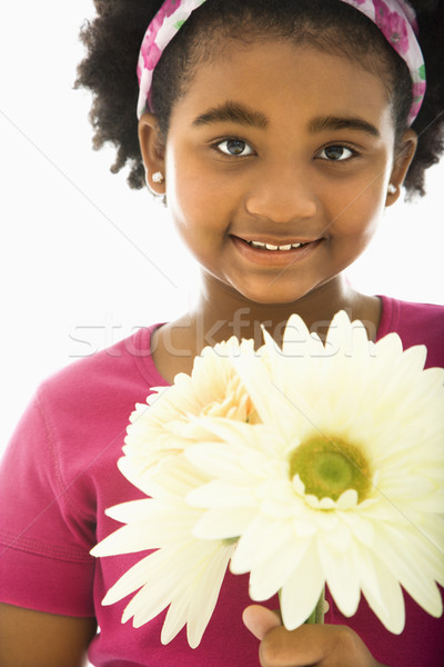 Girl holding bouquet. Stock photo © iofoto