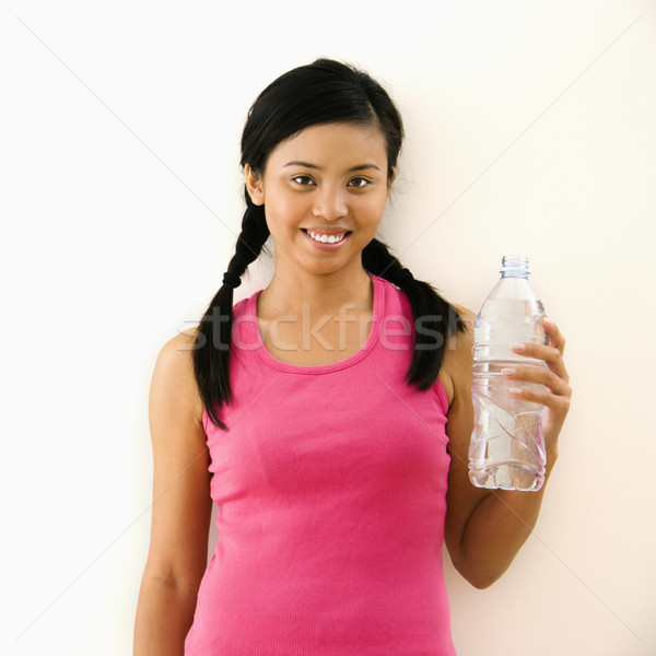 Woman with bottled water Stock photo © iofoto