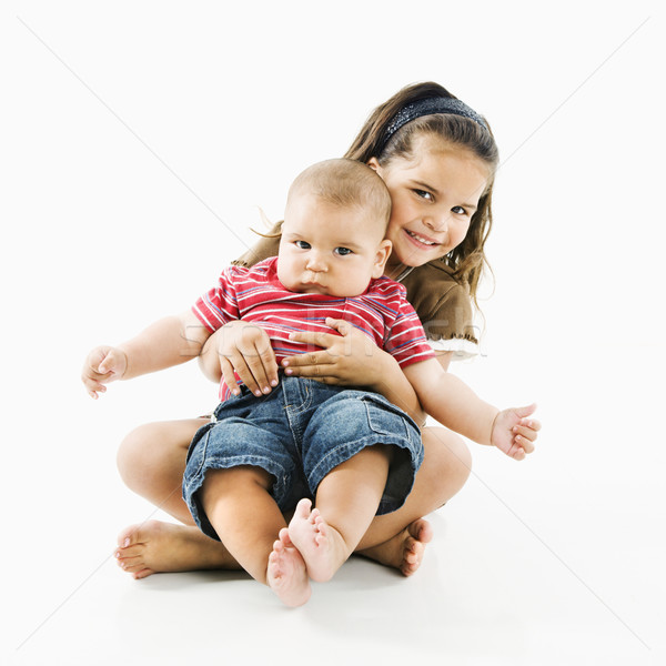 Hispanic child holding baby. Stock photo © iofoto
