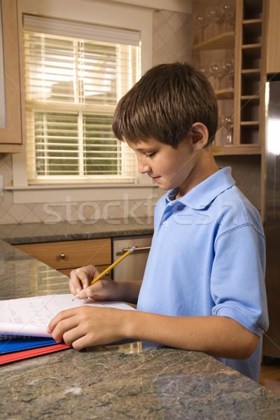 Erkek ödev kafkas mutfak tezgahı çocuk ev Stok fotoğraf © iofoto