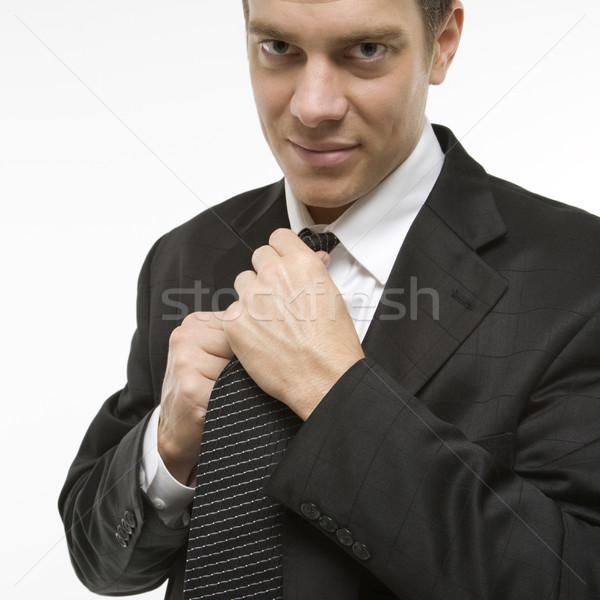 Man straightening necktie. Stock photo © iofoto