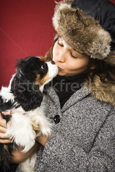 Woman kissing dog. Stock photo © iofoto
