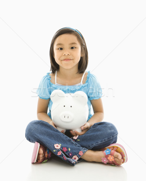Girl holding piggybank. Stock photo © iofoto