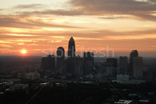 Cityscape at dusk. Stock photo © iofoto