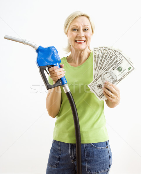 Happy woman with gas pump and money. Stock photo © iofoto