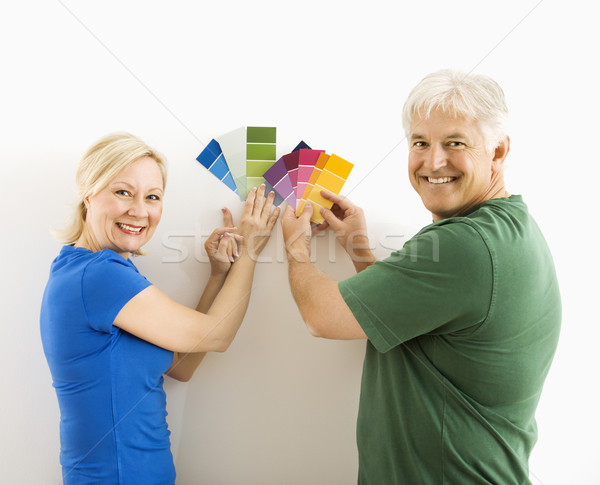 Man and woman comparing swatches. Stock photo © iofoto