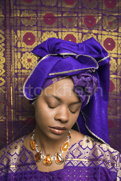 Stock photo: Young African American Woman in Traditional African Dress With Eyes Closed