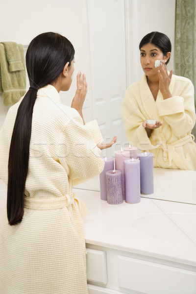 Young woman applying facial scrub. Stock photo © iofoto