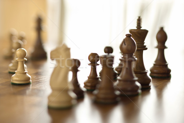 Chess pieces on chess board. Stock photo © iofoto