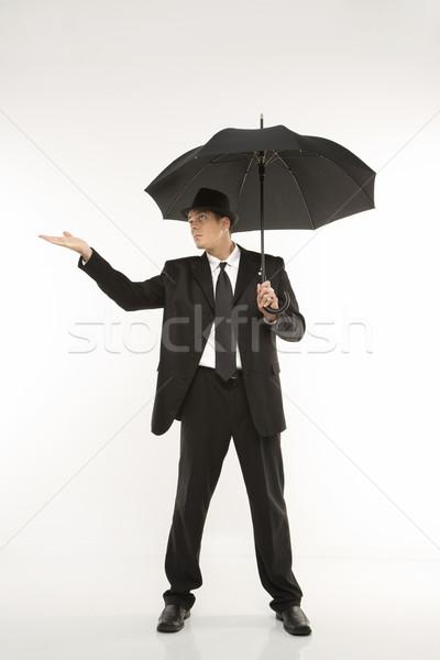 Lluvia caucásico empresario fedora Foto stock © iofoto
