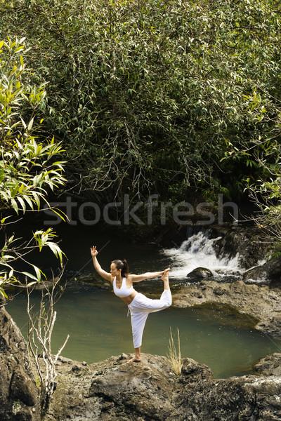 Asian woman doing yoga. Stock photo © iofoto