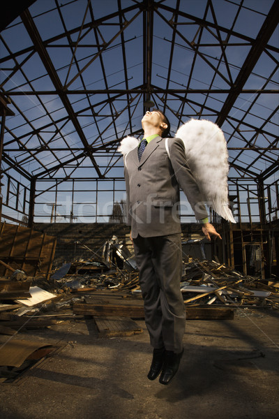 Young Businessman With Angel Wings Stock photo © iofoto