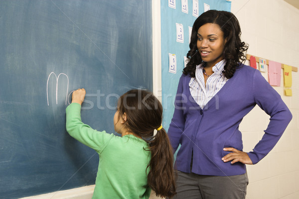 Teacher and Student at Blackboard Stock photo © iofoto