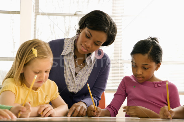 Teacher Helping Students With Schoolwork  Stock photo © iofoto