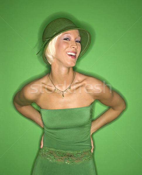 Pretty woman smiling. Stock photo © iofoto