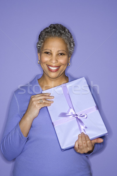 Woman holding present. Stock photo © iofoto
