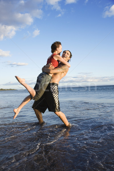 Romantic couple on beach. Stock photo © iofoto