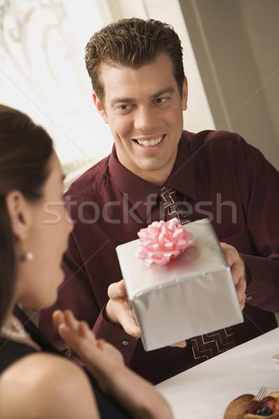 Man giving woman gift. Stock photo © iofoto