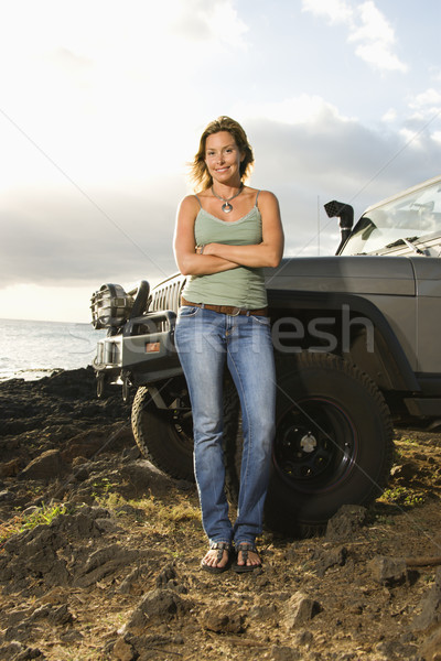 Woman by SUV at the Beach Stock photo © iofoto
