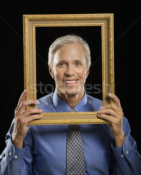 Człowiek ramki obrazu w średnim wieku biznesmen uśmiechnięty Zdjęcia stock © iofoto