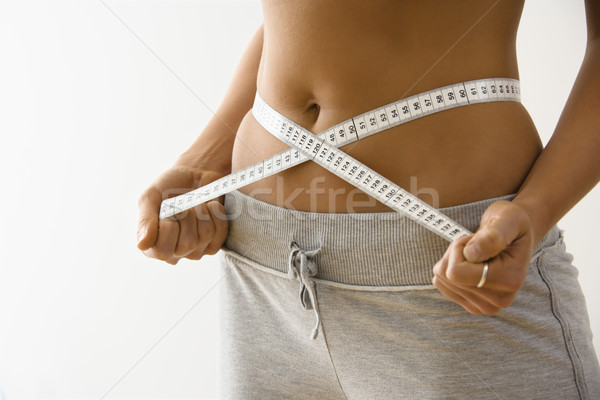 Woman losing weight Stock photo © iofoto