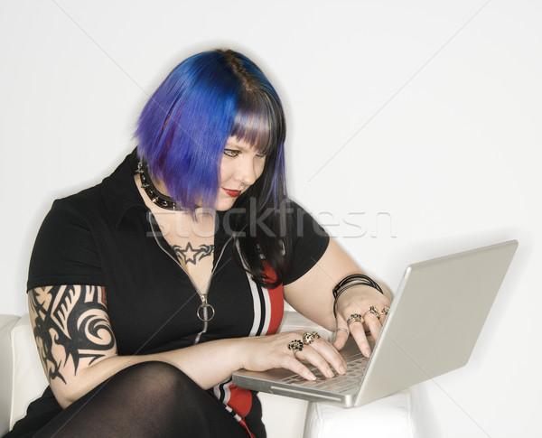Woman on laptop computer. Stock photo © iofoto