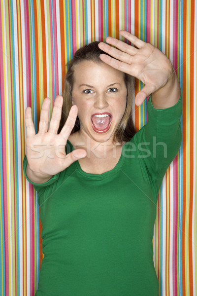 Woman making facial expression. Stock photo © iofoto