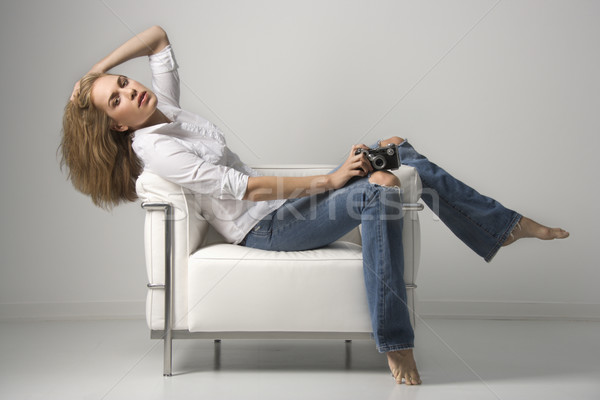 Fiatal nő ül szék profil ülő tart Stock fotó © iofoto
