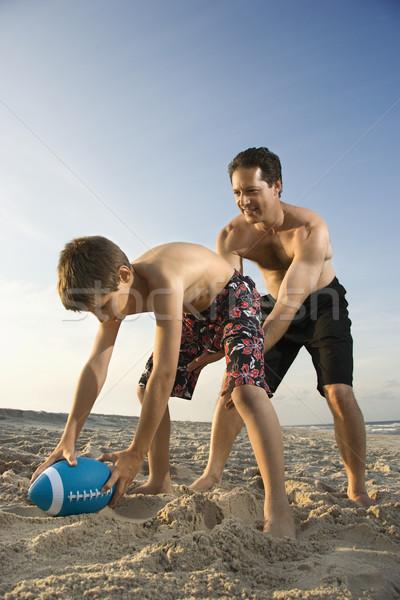 Boy hiking football to dad. Stock photo © iofoto