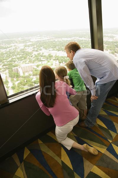Family at window. Stock photo © iofoto
