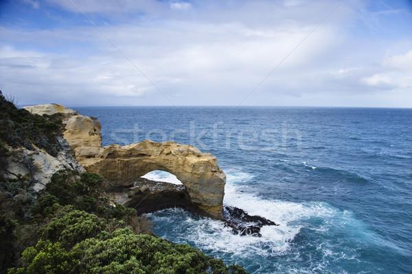 Rock arch in ocean. Stock photo © iofoto